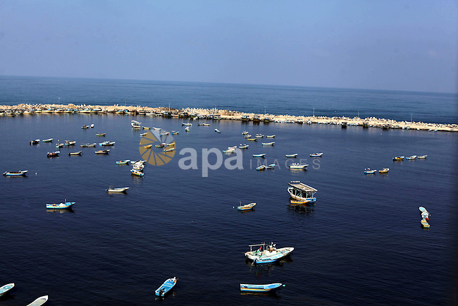 A general view shows fishermen's boats float at the Gaza seaport in the West of Gaza City, 02 September 2013. The Egyptian navy boats attacked the Palestinian boats off the southern Gaza Strip last Friday, near the border with Egypt, wounding fishermen and the arrest of 5 fishermen. Photo by Ashraf Amra