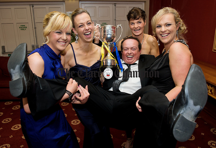 RTE's Marty Morrissey is blessed amongst women; Noelle Arthur, Michelle Wynne, Patricia Mc Carthy and Emily Lynch as he arrives in style at the Inagh Camogie Club Dinner Dance in the Falls hotel, Ennistymon, to help celebrate their Junior All-Ireland title win. Photograph by John Kelly.