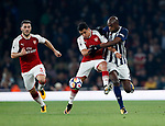 Arsenal's Alexis Sanchez tussles with West Brom's Allan Nyom during the premier league match at the Emirates Stadium, London. Picture date 25th September 2017. Picture credit should read: David Klein/Sportimage