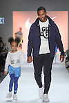 NFL Player Victor Curz walks runway with daugther Kennedy Cruz in outfits from the NIKE Fall 2017 children's collection, during the Rookie USA Fall 2017 kidswear fashion show, presented by Haddad Brands at NYFW: The Shows Fall 2017 at Skylight Clarkson Square on February 15, 2017.