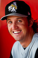 Joshua Spence (34) of the San Antonio Missions smiles in the dugout during a game against the Springfield Cardinals on May 30, 2011 at Hammons Field in Springfield, Missouri.  Photo By David Welker/Four Seam Images.