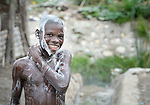 A boy bathes in Batey Bombita, a community in the southwest of the Dominican Republic whose population is composed of Haitian immigrants and their descendents.
