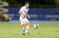 GEORGETOWN, GRAND CAYMAN, CAYMAN ISLANDS - NOVEMBER 19: Daniel Lovitz #5 of the United States passes off the ball during a game between Cuba and USMNT at Truman Bodden Sports Complex on November 19, 2019 in Georgetown, Grand Cayman.