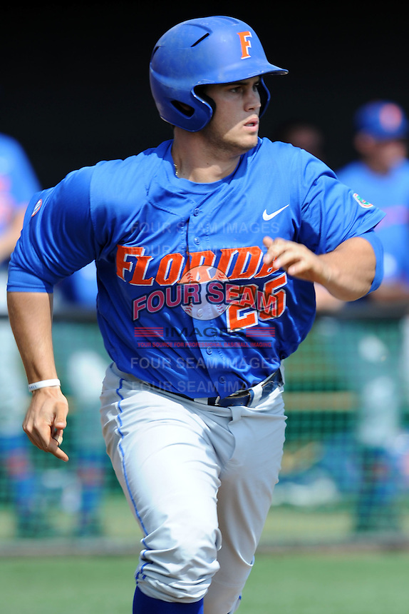 Florida Gators right fielder Preston Tucker #25 runs to first during a game against the Tennessee Volunteers at Lindsey Nelson Stadium, Knoxville, Tennessee April 14, 2012. The Volunteers won the game 5-4  (Tony Farlow/Four Seam Images)..