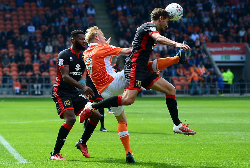 Blackpool's Mark Cullen stretches for the ball under pressure from Milton Keynes Dons' Edward Upson<br /> <br /> Photographer Richard Martin-Roberts/CameraSport<br /> <br /> The EFL Sky Bet League One - Blackpool v Milton Keynes Dons - Saturday August 12th 2017 - Bloomfield Road - Blackpool<br /> <br /> World Copyright &copy; 2017 CameraSport. All rights reserved. 43 Linden Ave. Countesthorpe. Leicester. England. LE8 5PG - Tel: +44 (0) 116 277 4147 - admin@camerasport.com - www.camerasport.com