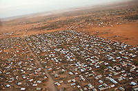 Dagahaley camp in Dadaab, Kenya. The sprawling rfugee camp complex in eastern Kenya is the largest in the world itha  population nearing 500,000 people. The camp grew enormously in 2011 as Somalis fled drought and civil war for the safe haven of Dadaab. Ifo extension can be seen in the distance. Oct 2011. Brendan Bannon/IOM/UNHCR