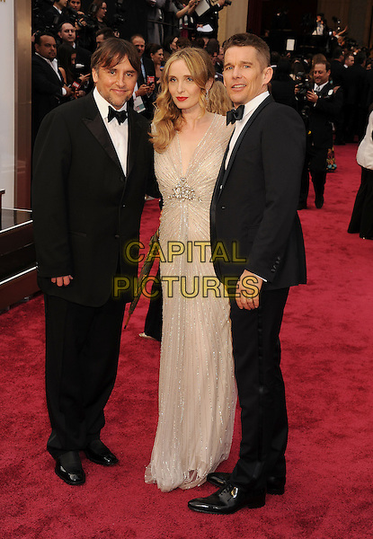 HOLLYWOOD, CA- MARCH 02: (L-R) Screenwriter Richard Linklater, actress/screenwriter Julie Delpy actor Ethan Hawke attend the 86th Annual Academy Awards held at Hollywood &amp; Highland Center on March 2, 2014 in Hollywood, California.<br /> CAP/ROT/TM<br /> &copy;Tony Michaels/Roth Stock/Capital Pictures