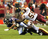 Landover, MD - August 25, 2007 --  Washington Redskins linebacker London Fletcher (59) flies in to help fellow linebacker Rocky McIntosh (52) tackle Baltimore Ravens wide receiver Demetrius Williams (87) in first half action at FedEx Field in Landover, Maryland on Saturday, August 25, 2007..Credit: Ron Sachs / CNP