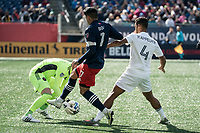 FOXBOROUGH, MA - MARCH 7: Kecceth Kronholm #18 of Chicago Fire retrieves the ball under Gustavo Bou #7 of New England Revolution with Johan Kappelhof #4 of Chicago Fire in support during a game between Chicago Fire and New England Revolution at Gillette Stadium on March 7, 2020 in Foxborough, Massachusetts.