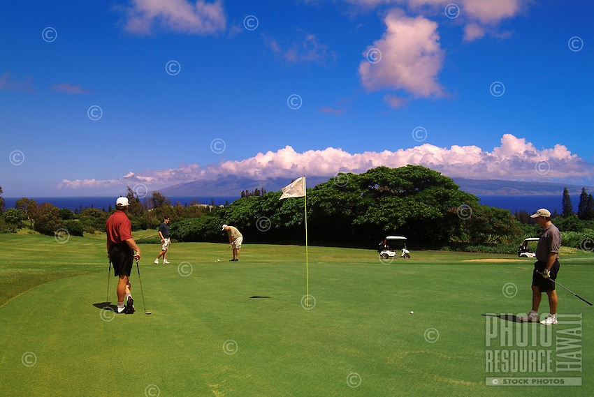 Men playing golf at Kapalua, Maui.