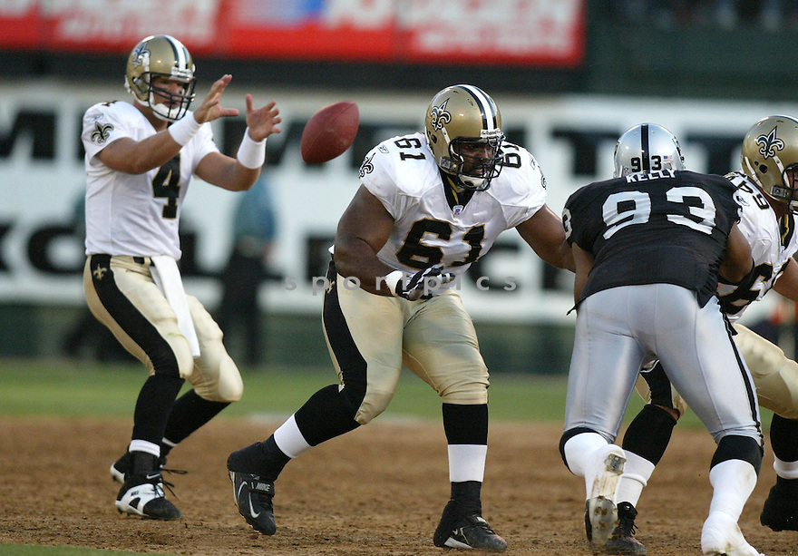 Montrae Holland, of the New Orleans Saints, during their game against the Oakland Raiders, on September 1, 2005..Raiders win 13-6..Rob Holt / SportPics.