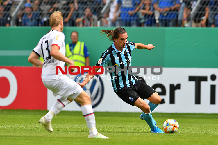 11.08.2019, Carl-Benz-Stadion, Mannheim, GER, DFB Pokal, 1. Runde, SV Waldhof Mannheim vs. Eintracht Frankfurt, <br /> <br /> DFL REGULATIONS PROHIBIT ANY USE OF PHOTOGRAPHS AS IMAGE SEQUENCES AND/OR QUASI-VIDEO.<br /> <br /> im Bild: Valmir Sulejmani (SV Waldhof Mannheim #9), David Abraham (Eintracht Frankfurt #19)<br /> <br /> Foto © nordphoto / Fabisch