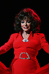 Joan Collins (GL) walks the runway of The Heart Truth's Red Dress Collection on February 11, 2010 at Mercedes-Benz Fashion Week - Fall 2010 Collections at Bryant Park, NYC. (Photo by Sue Coflin/Max Photos)