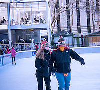 """Hardy visitors enjoy themselves ice skating in Bryant Park in New York on Tuesday, January 7, 2014 as the """"polar vortex"""" arrives in the city bringing with it record cold temperatures as low as four degrees. Arctic cold air arrived in the city with below zero wind chills and officials are recommending staying indoors and if you have to go out dress in layers. The city has activated the Winter Weather Emergency Plan where senior centers will close after lunch, the Dept. of Homeless Services will double its outreach program, and high-risk clients will be visited by social services among the coordinated city actions. (© Richard B. Levine)"""