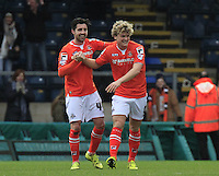 Cameron McGeehan of Luton Town (number 8) celebrates his winning goal with defender Alan Sheehan during the Sky Bet League 2 match between Wycombe Wanderers and Luton Town at Adams Park, High Wycombe, England on 6 February 2016. Photo by Liam Smith.