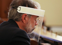 """United States Representative Andy Harris (Republican of Maryland) wears a face shield as he waits for Dr. Robert Redfield, Director of the Centers for Disease Control and Prevention to testify when the United States House Labor, Health and Human Services, Education and Related Agencies Subcommittee holds a hearing on """"COVID-19 Response on Capitol Hill in Washington, DC on Thursday, June 4, 2020. <br /> Credit: Tasos Katopodis / Pool via CNP/AdMedia"""