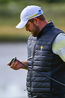 Marc Leishman (AUS) checks out his putter after barely missing a putt on 14 during round 3 Foursomes of the 2017 President's Cup, Liberty National Golf Club, Jersey City, New Jersey, USA. 9/30/2017.<br /> Picture: Golffile | Ken Murray<br /> <br /> All photo usage must carry mandatory copyright credit (&copy; Golffile | Ken Murray)