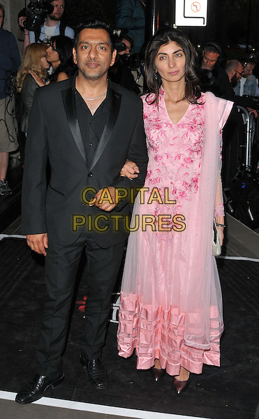 LONDON, ENGLAND - APRIL 17: Nitin Ganatra &amp; Meera Ganatra attend the Asian Awards 2015, Grosvenor House Hotel, Park Lane, on Friday April 17, 2015 in London, England, UK. <br /> CAP/CAN<br /> &copy;Can Nguyen/Capital Pictures