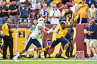 Landover, MD - SEPT 24, 2016: West Virginia Mountaineers wide receiver Shelton Gibson (1) beats BYU Cougars defensive back Chris Wilcox (32) during their match up at FedEx Field in Landover, MD. (Photo by Phil Peters/Media Images International)