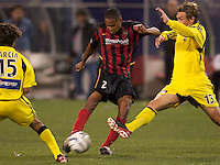 Ricardo Clark of the MetroStars puts the ball between Freddy Garcia and Brian Dunseth of the Crew. The Columbus Crew defeated the NY/NJ MetroStars 1-0 on 4/12/03 at Giant's Stadium, NJ.