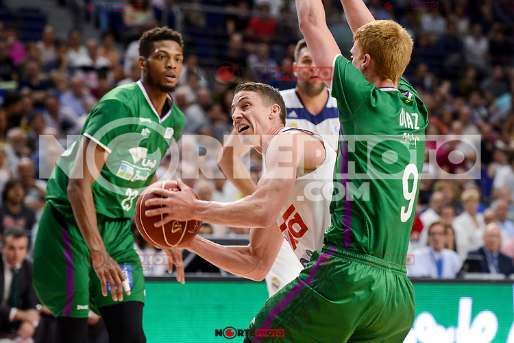 Real Madrid's Jaycee Carroll and Unicaja Malaga's Jeff Brooks and Alberto Diaz during semi finals of playoff Liga Endesa match between Real Madrid and Unicaja Malaga at Wizink Center in Madrid, June 02, 2017. Spain.<br /> (ALTERPHOTOS/BorjaB.Hojas) /NortePhoto.com
