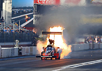 Feb 8, 2020; Pomona, CA, USA; NHRA top fuel driver Shawn Reed blows an engine on fire during qualifying for the Winternationals at Auto Club Raceway at Pomona. Mandatory Credit: Mark J. Rebilas-USA TODAY Sports