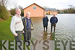 Joe Buckley, Christy Murphy, Jimmy Savage and PJ Hayes view the flooding at Saint Pat's Gaa club in Blennerville on Monday.