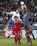 Sub keeper Mark Peat saves from Kevin Kyle.