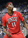 UNLV's Goodluck Okonoboh (11) reacts to the crowd after dunking during a college basketball game against Nevada in Reno, Nev., on Tuesday, Jan. 27, 2015. The Rebels won 67-62. (Las Vegas Review-Journal/Cathleen Allison)
