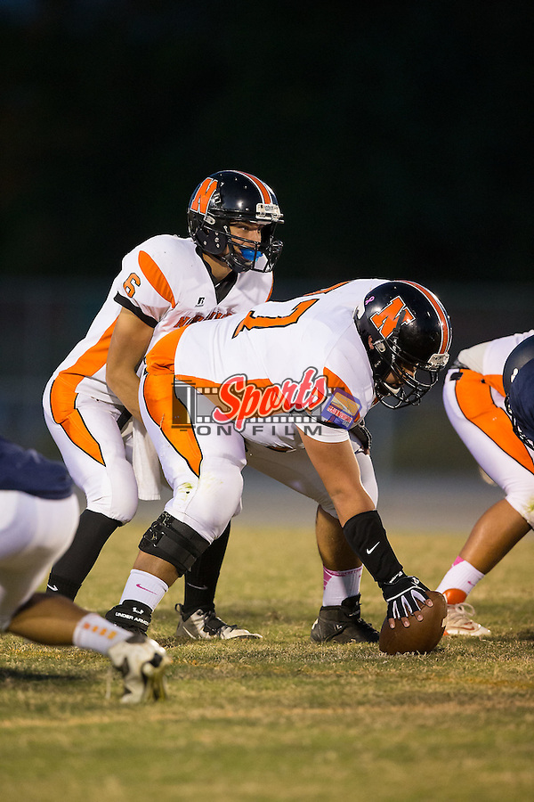 Chris Monteleone (6) of the Northwest Cabarrus Trojans lines up under center Tristan Westover (77) during first half action against the Carson Cougars at Jesse Carson High School on October 24, 2014, in China Grove, North Carolina.  The Cougars defeated the Trojans 35-6.  (Brian Westerholt/Sports On Film)