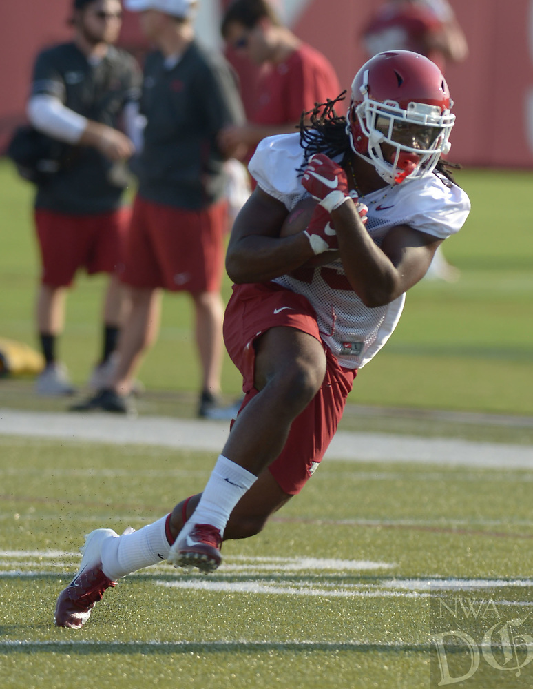 NWA Democrat-Gazette/ANDY SHUPE<br /> Arkansas running back Maleek Williams carries the ball Friday, Aug. 3, 2018, after making a catch during practice at the university practice field on campus in Fayetteville. Visit nwadg.com/photos to see more photographs from the practice.