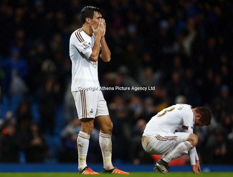 Jack Cork of Swansea City looks dejected during the Barclays Premier League match between Manchester City and Swansea City played at the Etihad Stadium, Manchester on December 12th 2015