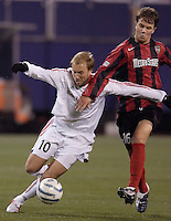 The MetroStars' Michael Bradley battles Clint Mathis of Real Salt Lake for the ball. The weather was the story with 50 mph winds, rain, and a brief power outage as the MetroStars played Real Salt Lake to a scoreless tie during opening day action of season 10 of the MLS at Giant's Stadium, East Rutherford, on Saturday April 2, 2005.