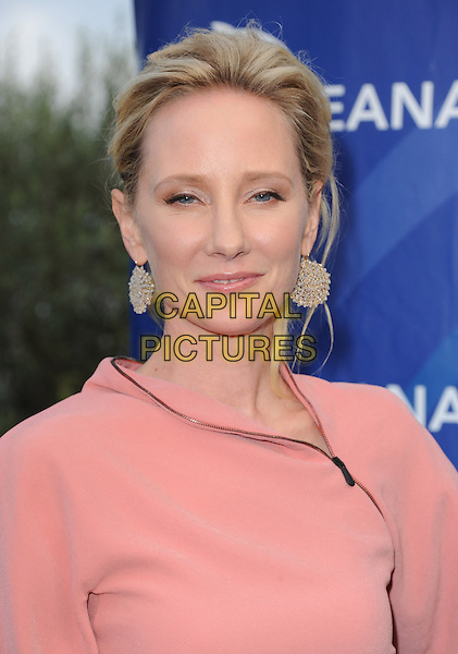 Anne Heche<br /> 6th Annual Oceana SeaChange Gala held at a Private Villa, Laguna Beach, California, USA.     <br /> August 18th, 2013<br /> headshot portrait pink gold circles earrings<br /> CAP/DVS<br /> &copy;DVS/Capital Pictures