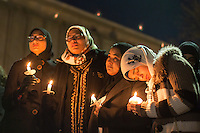 Meredith student Suzanne Askar (far right) mourns with thousands who gathered for a vigil and memorial for three shooting victims at The Pit at The University of North Carolina at Chapel Hill in Chapel Hill, North Carolina on Wednesday, February 11, 2015. Craig Hicks, 46, of Chapel Hill has been charged with three counts of first-degree murder in the killings of Deah Barakat, 23, a UNC student; his wife, Yusor Abu-Salha, 21; and her sister, Razan Abu-Salha, 19. (Justin Cook)