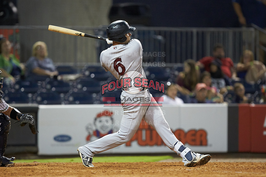 Ryan McBroom (6) of the Scranton/Wilkes-Barre RailRiders follows through on his swing against the Gwinnett Stripers at BB&T BallPark on August 17, 2019 in Lawrenceville, Georgia. The Stripers defeated the RailRiders 8-7 in eleven innings. (Brian Westerholt/Four Seam Images)