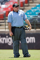 Home plate umpire Craig Barron between innings of the International League game between the Louisville Bats and the Charlotte Knights at Knights Stadium July 20, 2010, in Fort Mill, South Carolina.  Photo by Brian Westerholt / Four Seam Images