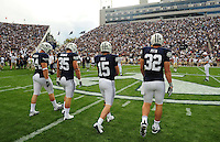 Sept. 19, 2009; Provo, UT, USA; BYU Cougars tight end (32) Dennis Pitta , quarterback (15) Max Hall and linebacker (35) Mike Bauman and defensive lineman (84) Jan Jorgensen head out for the coin toss prior to the game against the Florida State Seminoles at LaVell Edwards Stadium. Florida State defeated BYU 54-28. Mandatory Credit: Mark J. Rebilas-