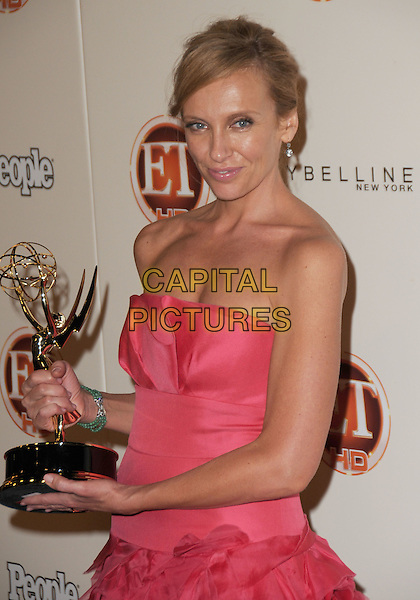 TONI COLLETTE.13th Entertainment Tonight Emmy Party Sponsored by People Magazine held at Vibiana, Los Angeles, California, USA..September 20th, 2009.emmys half length trophy award strapless pink dress green stone bracelet hair up.CAP/ADM/GS.©George Shepherd/AdMedia/Capital Pictures.