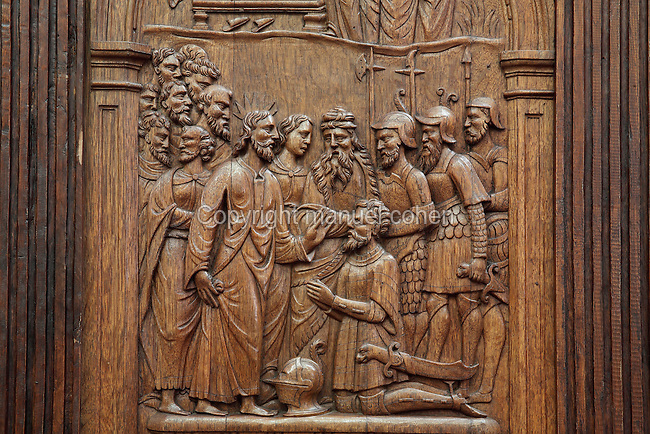 Detail of a wooden relief on a chair, possibly depicting Jesus blessing a soldier, 13th century, made for the choir but moved to the sacristy in 1935, in the Cathedrale Saint-Julien du Mans or Cathedral of St Julian of Le Mans, Le Mans, Sarthe, Loire, France. The cathedral was built from the 6th to the 14th centuries, with both Romanesque and High Gothic elements. It is dedicated to St Julian of Le Mans, the city's first bishop, who established Christianity in the area in the 4th century AD. Picture by Manuel Cohen