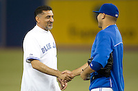 Canadian politician Baljit Gosal shakes hands with Ricky Romero after throwing out the first pitch before the Toronto Blue Jays game against the Boston Red Sox at Rogers Centre on June 3, 2012 in Toronto, Ontario.  (Mike Janes/Four Seam Images)
