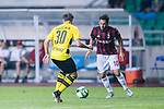 AC Milan Midfielder Hakan Calhanoglu (R) plays against Borussia Dortmund Midfielder Felix Passlack (L) during the International Champions Cup 2017 match between AC Milan vs Borussia Dortmund at University Town Sports Centre Stadium on July 18, 2017 in Guangzhou, China. Photo by Marcio Rodrigo Machado / Power Sport Images
