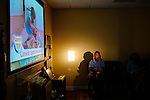 An expectant mother sits through a video during a class at the Pregnancy Aid Clinic in Hapeville, Georgia. The clinic offers women free support, including ultrasounds, pregnancy tests, classes, and supplies. Seen November 7, 2013.
