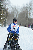 John Norris passes by University Lake during the first day of the World Championship Sled Dog Races, a highlight of the 2013 Anchorage, Alaska, Fur Rendezvous.