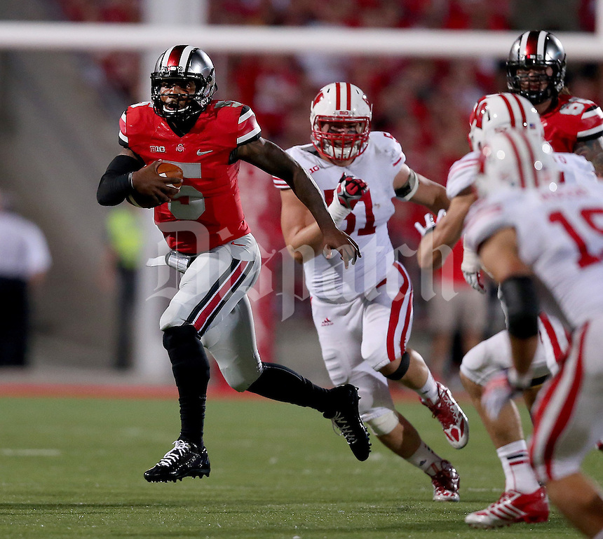 Ohio State Buckeyes quarterback Braxton Miller (5) runs during the second half of the game between Ohio State and Wisconsin at Ohio Stadium on Saturday, September 28, 2013. (Columbus Dispatch photo by Jonathan Quilter)