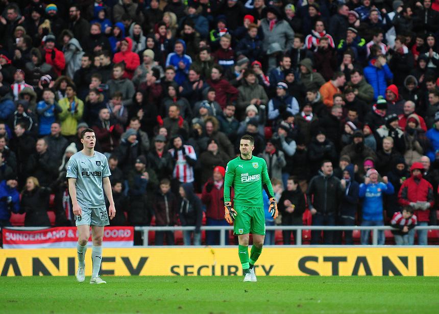 Burnley&rsquo;s Michael Keane, left, and Burnley's Thomas Heaton react after Sunderland&rsquo;s Jermain Defoe scored his sides second goal <br /> <br /> Photographer Chris Vaughan/CameraSport<br /> <br /> Football - Barclays Premiership - Sunderland v Burnley - Saturday 31st January 2015 - Stadium of Light - Sunderland<br /> <br /> &copy; CameraSport - 43 Linden Ave. Countesthorpe. Leicester. England. LE8 5PG - Tel: +44 (0) 116 277 4147 - admin@camerasport.com - www.camerasport.com