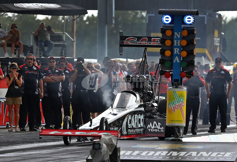 Aug. 31, 2013; Clermont, IN, USA: Crew for NHRA top fuel dragster driver Billy Torrence during qualifying for the US Nationals at Lucas Oil Raceway. Mandatory Credit: Mark J. Rebilas-
