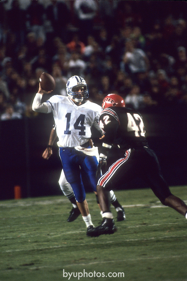 FTB 9111-196 SDSU<br /> <br /> BYU at San Diego State University. 14 Ty Detmer Quarterback.<br /> <br /> November 16, 1991<br /> <br /> Box Number: in office<br /> <br /> Photo by: Mark Philbrick/BYU<br /> <br /> Copyright BYU PHOTO 2008<br /> All Rights Reserved<br /> 801-422-7322<br /> photo@byu.edu