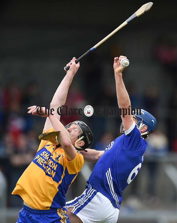 Niall Gilligan of Sixmilebridge in action against Conor Ryan of Cratloe during their game in Cusack Park. Photograph by John Kelly.