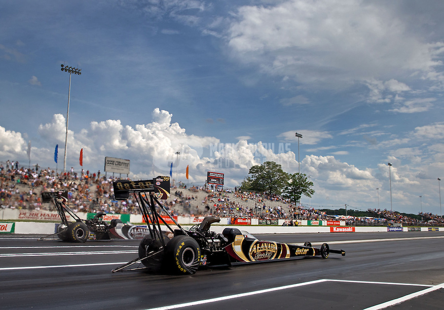 Jun. 2, 2013; Englishtown, NJ, USA: NHRA top fuel dragster driver Khalid Albalooshi (near lane) races alongside teammate Shawn Langdon during the finals of the Summer Nationals at Raceway Park. Mandatory Credit: Mark J. Rebilas-